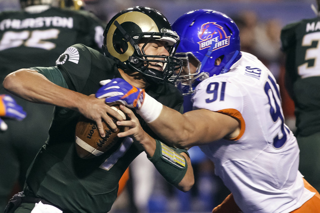 Colorado State quarterback Nick Stevens (7) is sacked by Boise State defensive end Durrant Miles (91) during the second half of an NCAA college football game in Boise, Idaho, Saturday, Oct. 15, 20 ...