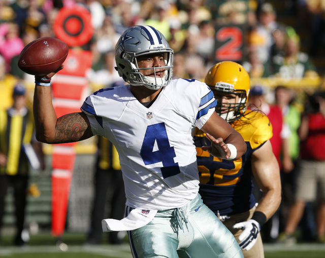 Dallas Cowboys' Dak Prescott throws during the first half of an NFL football game against the Green Bay Packers Sunday, Oct. 16, 2016, in Green Bay, Wis. (Mike Roemer/The Associated Press)