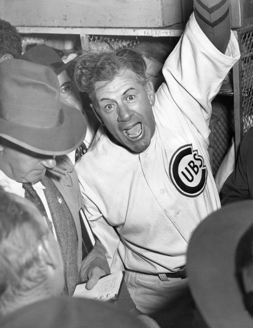 In this Oct. 8, 1945 file photo, Chicago Cubs manager Charlie Grimm Manager celebrates the Cubs 8-7 victory in the sixth game of the World Series in 12 innings at Wrigley Field in Chicago.  (Mel L ...