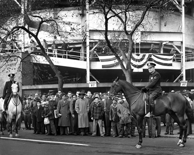 In this Oct. 10, 1945, photo, fans wait to buy bleacher tickets to the seventh game of the World Series between the Chicago Cubs and Detroit Tigers at Wrigley Field in Chicago.   (Mel Larson/Chica ...