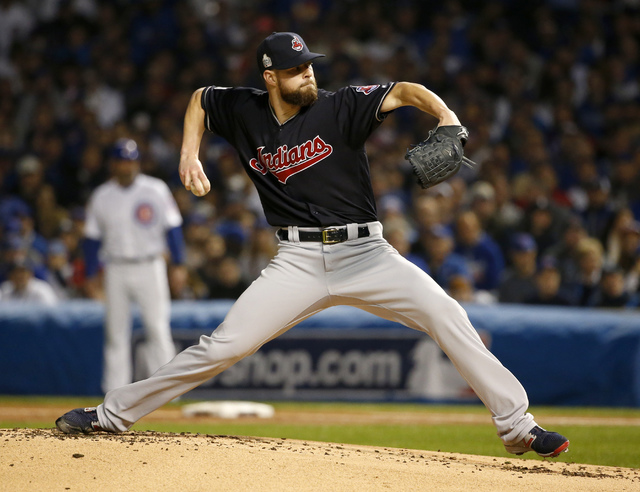 Cleveland Indians starting pitcher Corey Kluber throws during the first inning of Game 4 of the World Series against the Chicago Cubs, Saturday, Oct. 29, 2016, in Chicago. (Nam Y. Huh/The Associat ...