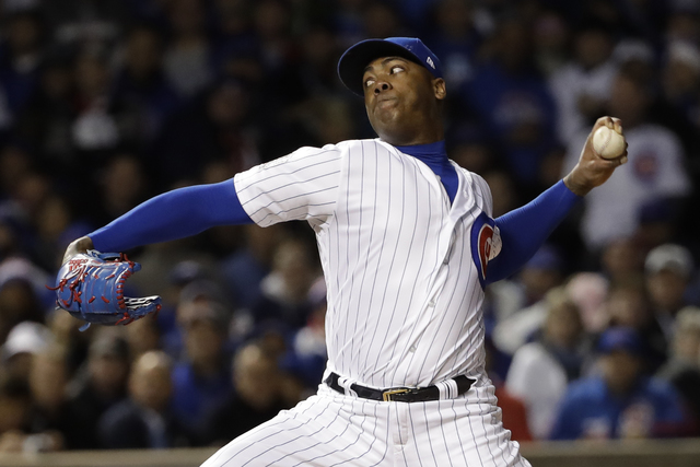 Chicago Cubs relief pitcher Aroldis Chapman throws during the seventh inning of Game 5 of the World Series on Sunday, Oct. 30, 2016, in Chicago. (David J. Phillip/The Associated Press)