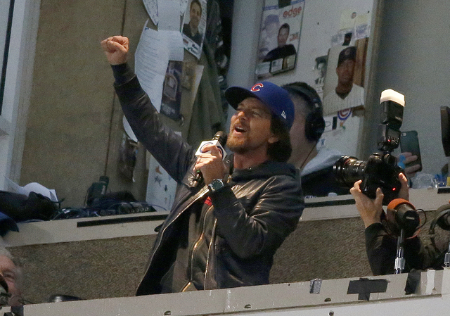 """Eddie Vedder sings """"Take Me Out to the Ballgame"""" during the seventh inning of Game 5 of the World Series between the Cleveland Indians and the Chicago Cubs Sunday, Oct. 30, 2016, in Chicago. (Nam  ..."""