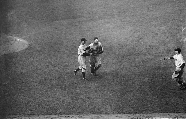 Detroit Tigers' Hal Newhouser, left, winning pitcher and Catcher Bob Swift, right, who relieved injured Paul Richard, walk off the field after their team won the World Series at Wrigley Field, Chi ...