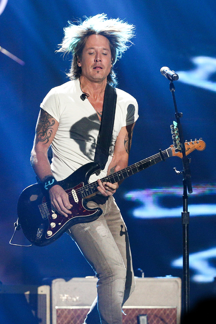 Keith Urban performs during the 2016 iHeartRadio Country Festival held at Frank Erwin Center on Saturday, April 30, 2016, in Austin, Texas. (Photo by John Salangsang/Invision/AP)