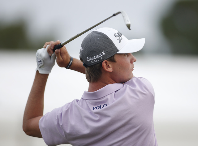 Smylie Kaufman hits on the driving range during the final round of the Shriners Hospitals for Children Open golf tournament Sunday, Oct. 25, 2015, in Las Vegas. Kaufman shot a 10-under-par during  ...