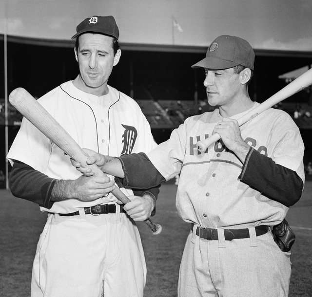 Detroit Tigers left fielder Hank Greenberg, left, and Chicago Cubs first baseman Phil Cavarretta whose powerful bats were a decisive factor in squaring off the first and second World Series game h ...