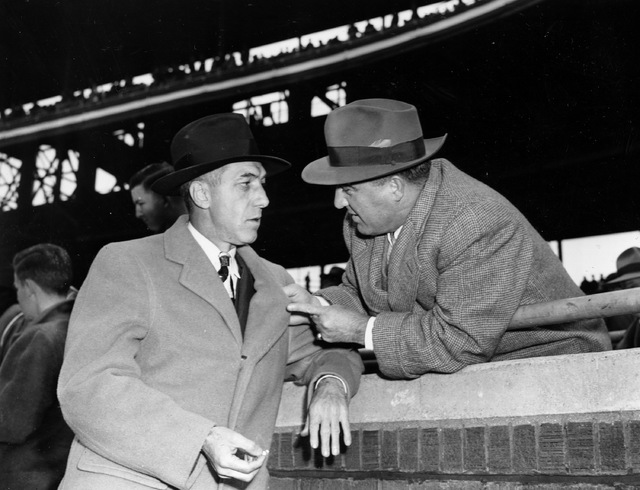 Baseball commissioner A.B. Chandler, right, talks with National League President Ford Frick before the final World Series game in Chicago, Oct. 10, 1945. The Detroit Tigers won 4 games and Chicago ...