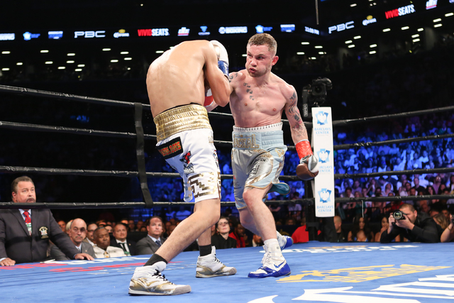 Carl Frampton, right, throws a punch at Leo Santa Cruz during their WBA Super World Featherweight Championship fight at the Barclays Center in the Brooklyn borough of New York on Saturday, July 30 ...