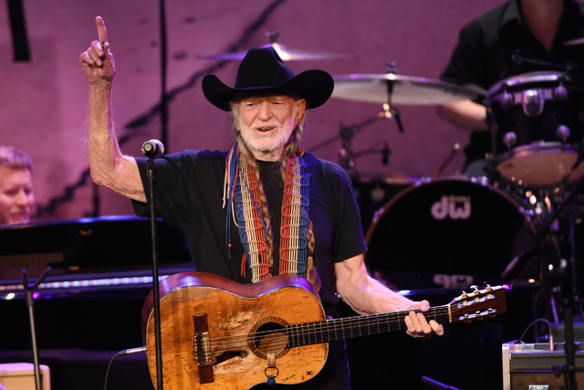 In this Feb. 5, 2015 file photo, Willie Nelson performs at the 17th Annual GRAMMY Foundation Legacy Concert at the Wilshire Ebell Theatre in Los Angeles. (Chris Pizzell/Invision/AP)