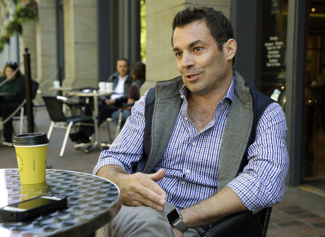 Chris Hansen, the investor attempting to build a new NBA basketball and NHL hockey arena in Seattle, takes part in an Associated Press interview, Tuesday, May 26, 2015, at a cafe in Seattle not fa ...