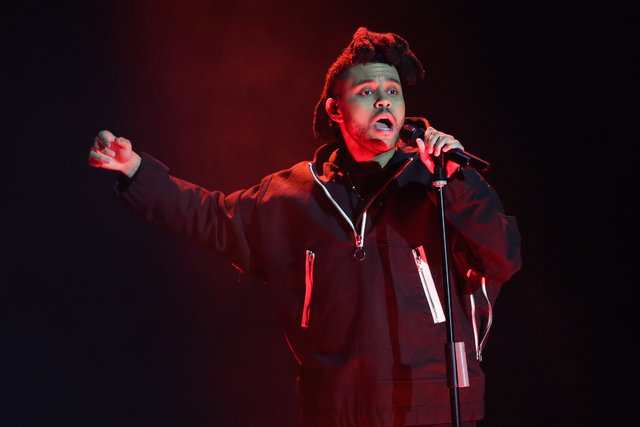 FILE - In this April 7, 2016, file photo, The Weeknd performs during the 2016 Echo Music Award ceremony in Berlin. Kanye West and The Weeknd will headline the first edition of the Meadows Music an ...