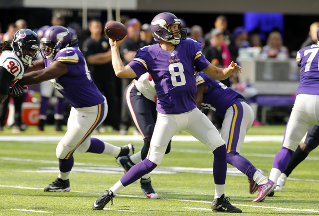 Minnesota Vikings quarterback Sam Bradford throws a pass during the first half of an NFL football game against the Houston Texans Sunday, Oct. 9, 2016, in Minneapolis. (AP Photo/Jim Mone)