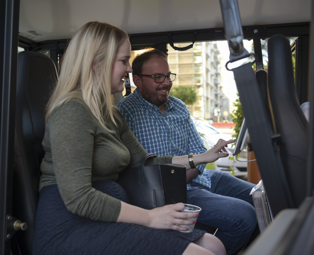 Ashly Anderson, left, of the Tampa Downtown Partnership, and Jeremy Rex, of the City of Tampa, use with a tablet that provides information about restaurants, during the first day of operation of D ...