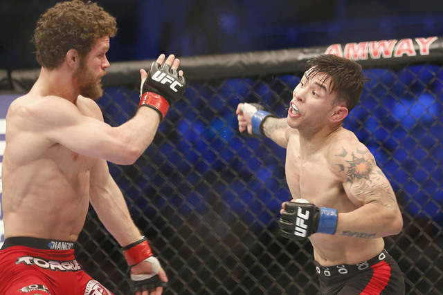 Dustin Ortiz, left, and Ray Borg fight in a mixed martial arts event on Saturday, April 19, 2014, at UFC Fight Night in Orlando Fla.. Ortiz won. (Reinhold Matay/AP)