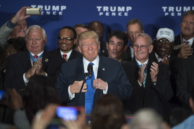 Republican presidential candidate Donald Trump attends a campaign event with veterans at the Trump International Hotel on Pennsylvania Ave., Sept. 16, 2016. (Tom Williams/CQ Roll Call via AP)