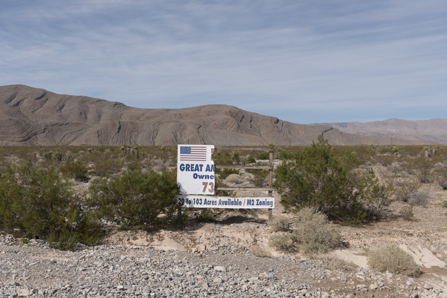 Beaten-up signage sits in front of the approximately 180 acres of land purchased by Scott Gragson and partners at the Apex Industrial Park near U.S. 93 and Interstate 15 in North Las Vegas, Wednes ...
