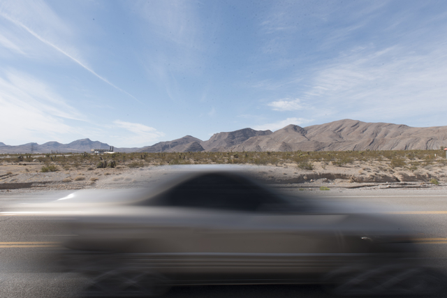 A car passes by the approximately 180 acres of land purchased by Scott Gragson and partners at the Apex Industrial Park near U.S. 93 and Interstate 15 in North Las Vegas is seen, Wednesday, Oct. 1 ...
