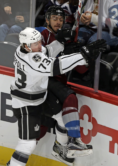 Colorado Avalanche defenseman Duncan Siemens, right, is checked into the boards by Los Angeles Kings forward Tyler Toffoli (73) during the first period of a preseason NHL hockey game, Friday, Sept ...