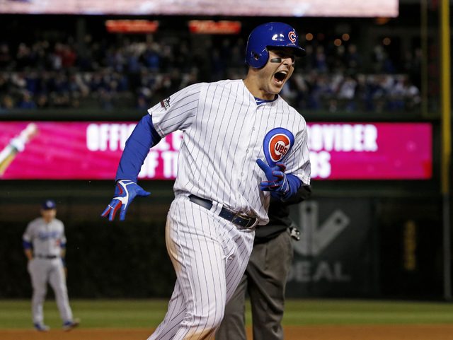 Chicago Cubs first baseman Anthony Rizzo celebrates as he runs bases after hitting a home run during the fifth inning of Game 6 of the NLCS on Saturday, Oct. 22, 2016, in Chicago. (Nam Y. Huh/The  ...