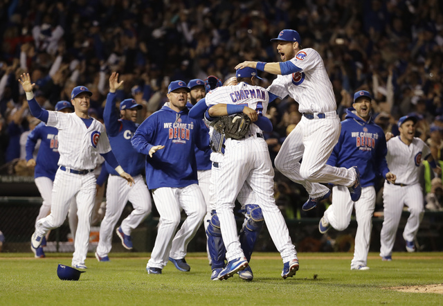 Chicago Cubs players celebrate after Game 6 of the NLCS against the Los Angeles Dodgers, Saturday, Oct. 22, 2016, in Chicago. (David J. Phillip/The Associated Press)