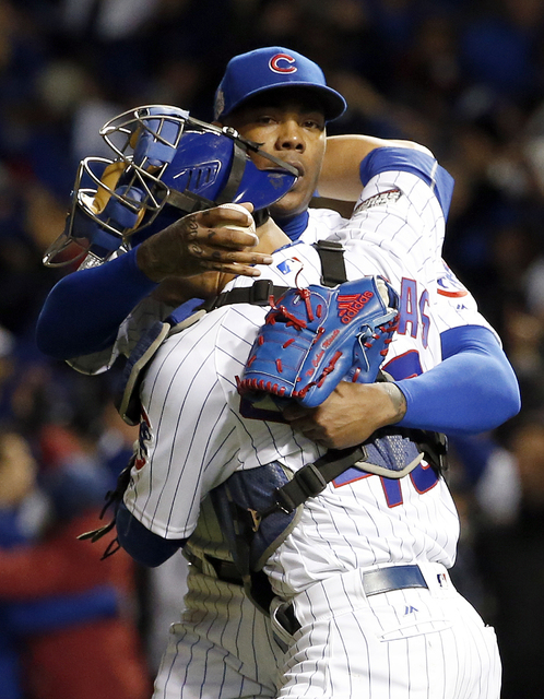 Chicago Cubs relief pitcher Aroldis Chapman and catcher Willson Contreras celebrate after Game 5 of the World Series on Sunday, Oct. 30, 2016, in Chicago.  (Nam Y. Huh/The Associated Press)