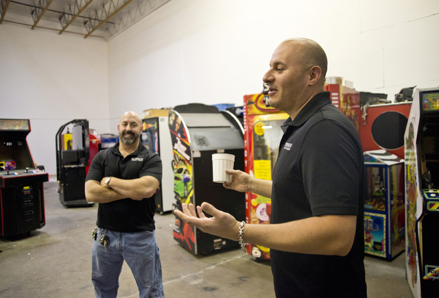 Larry Galbraith, right, and James Angelone, of Superior Games & Vending, speak with a reporter inside their repair shop and warehouse in North Las Vegas on Tuesday, Oct. 11, 2016. Daniel Clark ...