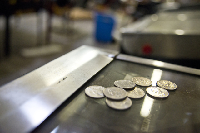 A pile of quarters sit on top of a pinball machine inside the Superior Games & Vending repair shop and warehouse in North Las Vegas on Tuesday, Oct. 11, 2016. Daniel Clark/Las Vegas Review-Jou ...