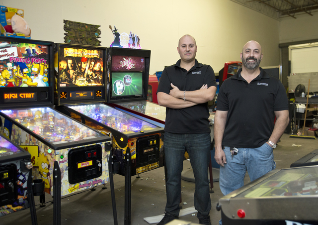 Larry Galbraith, right, and James Angelone, of Superior Games & Vending, pose inside their repair shop and warehouse in North Las Vegas on Tuesday, Oct. 11, 2016. Daniel Clark/Las Vegas Review ...