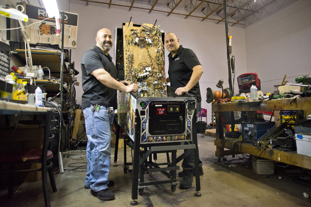 Larry Galbraith, right, and James Angelone, of Superior Games & Vending, pose for a portrait inside their repair shop and warehouse in North Las Vegas on Tuesday, Oct. 11, 2016. Daniel Clark/L ...