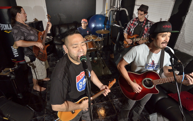Dr. Alan Ikeda, second from left, performs with band mates, from left, Joe Atanacio, Dennis Garza, Sami Saula and Jay Russo during a Rydmik Healing rehearsal at Ikedaճ home in Las Vegas on T ...