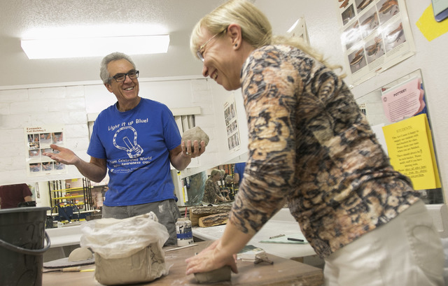 Osteopathic physician and Touro University professor Dr. Robert Kessler, left and colleague Dr. Lise Rioux share a laugh during their pottery class at the Boulder City Art Center on Monday, Sept.  ...