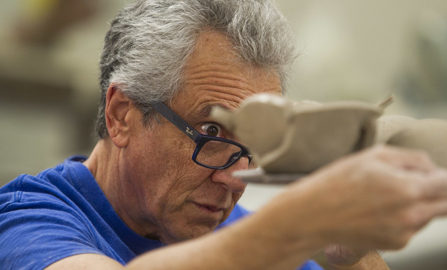 Osteopathic physician and Touro University professor Dr. Robert Kessler takes a close look at his clay pot during his pottery class at the Boulder City Art Center on Monday, Sept. 12, 2016. (Richa ...