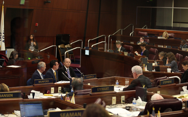 Southern Nevada Tourism and Infrastructure Committee Chairman Steve Hill, Jeremy Aguero of Applied Analysis and Guy Hobbs of Hobbs, Ong & Associates address the Nevada Assembly during a specia ...