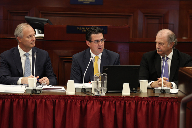 Southern Nevada Tourism and Infrastructure Committee Chairman Steve Hill (left), Jeremy Aguero of Applied Analysis (middle) and Guy Hobbs of Hobbs, Ong & Associates (right) speak during the Ne ...