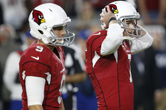 Arizona Cardinals kicker Chandler Catanzaro watches as his game-winning field goal attempt sail wide left as punter Ryan Quigley (9) looks on attempt during overtime of Sunday's game against the S ...