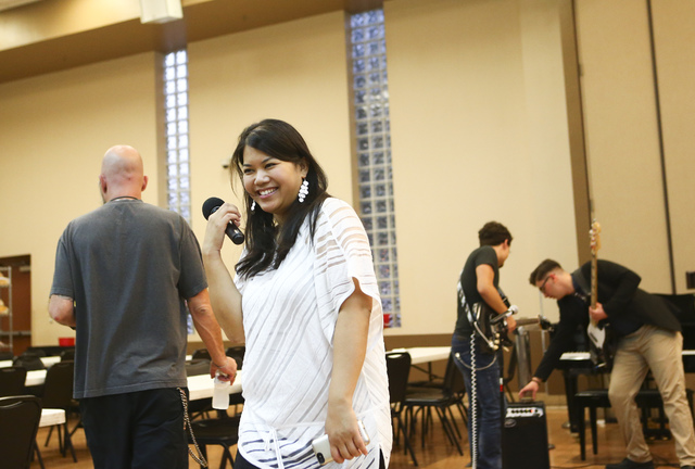 Alexandria Le, executive artistic director of Notes With a Purpose, introduces student musicians at the Las Vegas Rescue Mission at weekly Wednesday performances for Las Vegas Rescue Mission diner ...