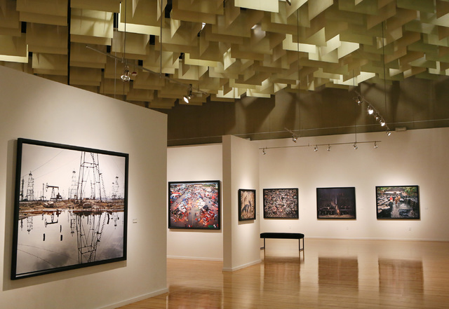 """Edward Burtynsky's photography exhibit """"Oil"""" explores the title resource's impact on our lives -- and our planet -- in three sections: """"Extraction and Refinement,"""" """"Transportation and Motor  ..."""