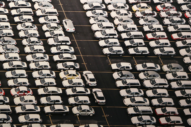 "Photographer Edward Burtynsky's overhead view of cars and more cars at a Houston car lot -- ""VW Lot #1"" -- is part of ""Oil,"" more than 50 images shot around the world, now on display at UNLV's Mar ..."