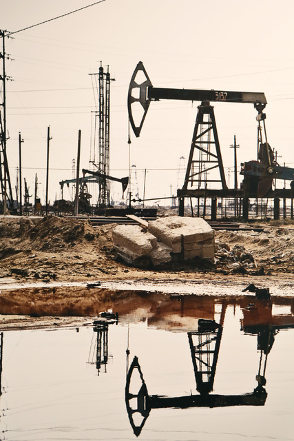 "Oil wells in Baku, Azerbaijan provide global perspective for photographer Edward Burtynsky, whose project ""Oil"" explores the petroleum industry's impact in more than 50 images on display at UNLV's ..."