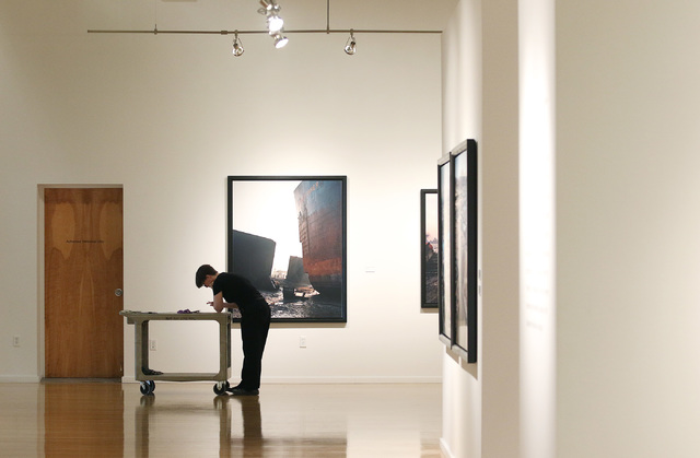 "Gallery worker Deanne Sole prepares for the opening of Edward Burtynsky's photography exhibit ""Oil"" at UNLV's Marjorie Barrick Museum. Ronda Churchill/Las Vegas Review-Journal"