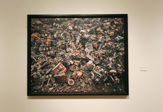 "A junkyard in Hamilton, Ontario, supplies the backdrop for Canadian photographer Edward Burtynsky's ""Scrap Auto Engines #11,"" one of more than 50 images that make up his exhibit ""Oil,"" now at  ..."