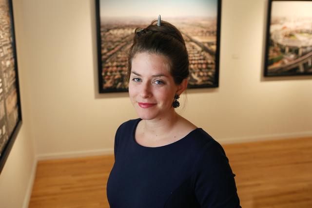 "Edward Burtynsky's photography exhibit ""Oil,"" now at UNLV's Marjorie Barrick Museum, surrounds interim gallery director Alisha Kerlin. Ronda Churchill/Las Vegas Review-Journal"