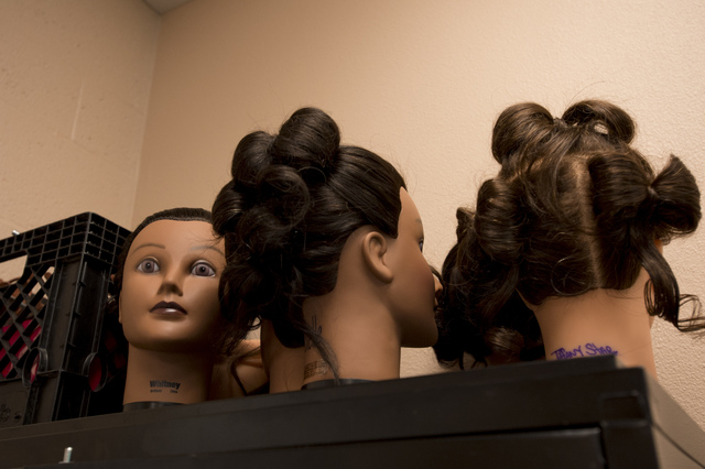Hair-cutting mannequin heads are stored on top of a cabinet during a cosmetology class on Thursday, June 30, 2016, at Florence McClure Women's Correctional Center in North Las Vegas. (Bridget Benn ...