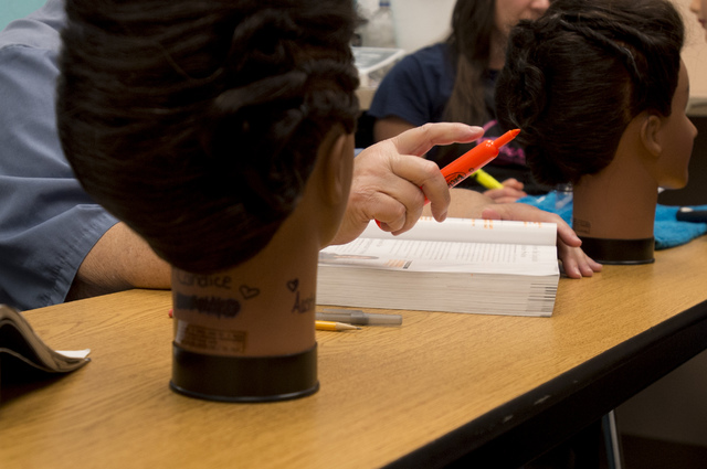 Inmate Nancy Collins holds a highlighter while she listens to her instructor on Thursday, June 30, 2016, at Florence McClure Women's Correctional Center in North Las Vegas. (Bridget Bennett/Las Ve ...