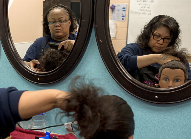Inmates Kimala Kimble, left, and Candice Austin practice updos on hair mannequins on Thursday, June 30, 2016, at Florence McClure Women's Correctional Center in North Las Vegas. (Bridget Bennett/L ...