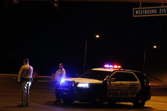 Metro cars block the westbound ramp to the 215 Beltway as police investigate a fatal officer-involved shooting in northwest Las Vegas, Thursday, Oct. 13, 2016. (Chitose Suzuki/LasVegas Review-Journal)