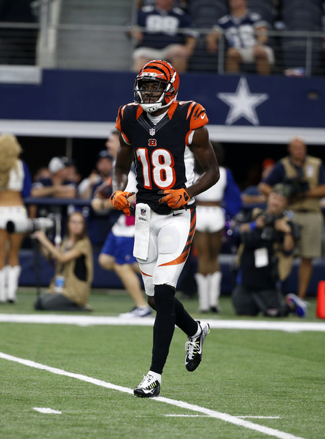 Cincinnati Bengals wide receiver A.J. Green (18) jogs off the field during an NFL football game agains the Dallas Cowboys on Sunday, Oct. 9, 2016, in Arlington. (AP Photo/Michael Ainsworth)
