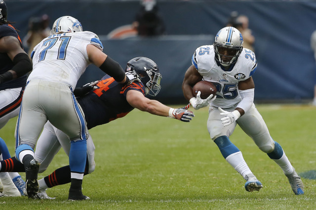 Detroit Lions running back Theo Riddick (25) carries the ball during the second half of an NFL football game against the Chicago Bears, Sunday, Oct. 2, 2016, in Chicago. (AP Photo/Charles Rex Arbo ...