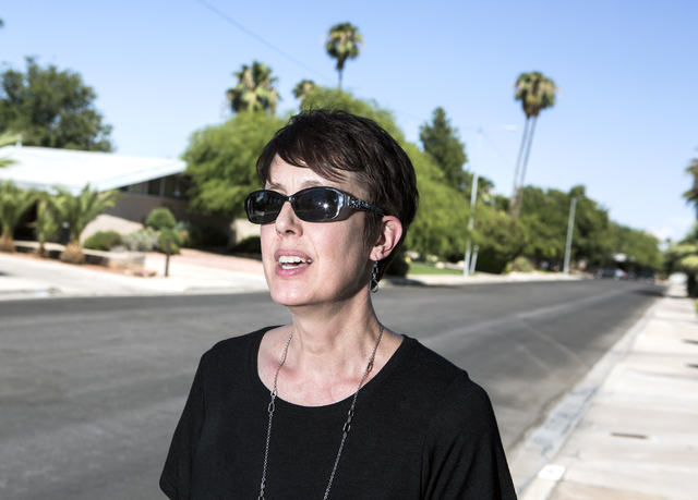 Nevada Preservation director Heidi Swank stands on the sidewalk at Barbara Way in the Beverly Green neighborhood on Friday, Aug. 12, 2016. The Las Vegas Planning Commission recently recommended a  ...